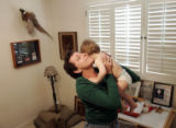 Caroline Cathey (cq) holds her grandson Jimmy Cathey close to her cheek on February 17, 2007, in...