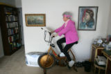 93-year-old Marion Downs (cq), rides her stationary bicycle in her bedroom on February 5, 2007, in...