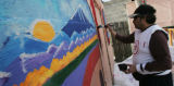 "[JPM201] Mark G. Martinez Luna paints a mural called ""A Pleasant Village"" on a shed..."