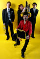 The members of local Denver based band Devotchka : Nick Urata (FRONT) (left to right) Shawn King,...