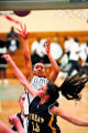 (DLM6460) -  Montbello junior Danielle Brown gets off a shot over Wheat Ridge senior Tara Easter...