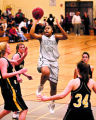 (DLM6555) -  Montbello senior Desiree Frierson drives to the basket past several Wheat Ridge...