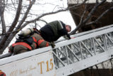 Forth floor resident Thomas Ochsner (cq) is rescued as Denver firefighters battled  a high rise...