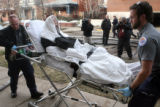 Mark Burger ,51, (name form apartment managers records)  is taken to an area hospital as Denver...