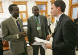Lado Jurkin, left, a case manager with the Denver based African Community Center and David Deng...