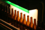 (DLM0157) -  Conveyors move finished bottles along to where they will be shipped out at the...