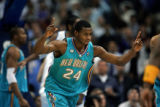 The New Orleans Hornets Desmond Mason (#24) reacts after a tip in that tied the game at 103 during...