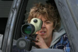 Birder April Adler (cq), from Aurora, does some birding Monday morning, February 19, 2007, at ...