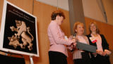Alongside the new Lion of Judah logo are Judy Altenberg, Ruth Toltz (receiving the Kipnis...