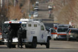 (DLM7600) -  Denver SWAT team members point their weapons toward a townhome where a suicidal man...