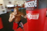 "(DLM1487) -  Andre ""The Silencer"" Walker hits the bag at T's KO Fight Club, a gym where..."
