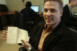 Dan Daughtery (cq) ,CEO of Rent Marketer in Englewood, holds the original plan for his business...