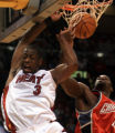 FLLA108 - Miami Heats Dwyane Wade (3) dunks the ball against Charlotte Bobcats' Emeka Okafor...