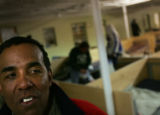 Michael Taylor (CQ), 53, of Denver, Colo., sits in the Crossroads homeless shelter located at 29th...