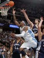 Denver Nuggets forward Carmelo Anthony is fouled by Memphis Grizzlies Pau Gasol, right, in the...