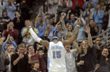 Denver Nuggets forward Carmelo Anthony salutes the crowd in the fourth quarter of play after...