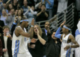 Denver Nuggets forward Carmelo Anthony  gets a high five from new teammate Allen Iverson as he...