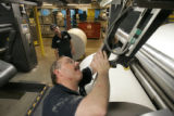 BG0041 Workers adjust the newly formated Rocky Mountain News regional edition during the Rocky's...