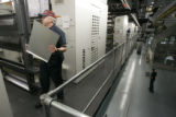 BG0085  Workers adjust the newly formated Rocky Mountain News regional edition during the Rocky's...
