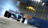 (DENVER, Co., Shot 8/13/2004)  Indeck-Forsythe Championship Racing's Paul Tracy (#1) smokes his...