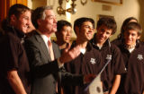 (Denver, Colo., May. 12, 2004) Gov. Bill Owens presents soccer players and coaches of the 86'...
