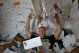 Columbine High School senior Ryan Miller (CQ) throws up the hundreds of recruiting letters he...