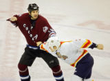 The Florida Panthers' Steve Montador (#7, D) squares off with the Colorado Avalanche's Ian...