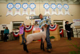 Cole Burson and his Grand Champion lamb.(STEVE PETERSON/SPECIAL TO THE NEWS) The 2007 Auction of...