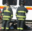 A man waits for medical attention after being taken from a light rail train which it stuck a PT...