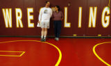 (DLM4263) -  Vicky Quinlin and her husband Barry Quinlin, an assistant wrestling coach, watch...