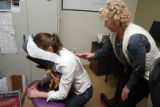 L to R: Stephanie Johnson (cq), Account Manager of Rent Marketer in Englewood, gets a massage from...