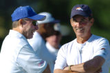 (DOVE VALLEY, Co., SHOT 7/30/2004) Denver Broncos' head coach Mike Shanahan (right) laughs with...