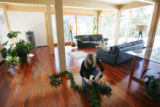 Maryanne Bruno (cq) takes down Christmas decorations in the house she lives in with her husband...