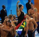 (Athens, Greece  on Sunday, Aug. 15, 2004) - As American Michael Phelps, left, congratuates a...