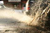 A motorist hits a water filled pothole along Emerson Street, Feb. 5, 2007, between Tennessee and...