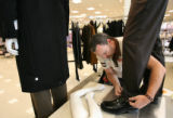 MJM1577 Tony Cox (cq) of San Jose, Calif. dresses a mannequin Friday as employees prepare for the...