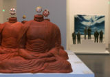 Michael Joo's 'Headless'  and in the background Juan Munoz's Untitled (Six Figures) in Denver,...