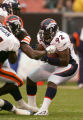 Elvis Dumervil intercepts a pass in the second quarter of the Denver Broncos against the Cleveland...