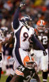 Former Brown, Michael Myers celebrates after stopping Reuben Droughns in the third quarter of the...