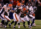 Tatum Bell tries to wriggle out of the grasp of the Browns defense in the fourth quarter of the...