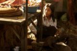 Kampong Chhnang, Cambodia.  November 4, 2003.      Sixteen-year-old Leakhana Hi prepares a fire to...
