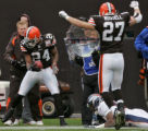 Cleveland Browns defensive back Gary Baxter ,left, picks off a pass thrown to Denver Bronco wide...
