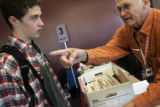 Colorado State University freshman Sean Ryan (l) (cq), 18, gets ready to vote for his first time...