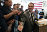 Ed Perlmutter shakes hands with members of the F.O.P (L-R) Officer Michael Jackson (cq) (hands...