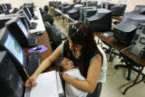 Carmen Hernandez (cq), 16, holds her 1-month-old son, Angel, during class at Hope Learning Center...