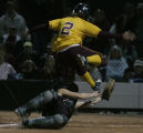In the 4th inning Windsor's Dani Finkelstein leaps to a run over Berthouds cathcer Alisa Heronema...