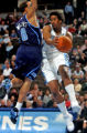 Denver Nuggets guard Andre Miller looks to pass the ball being defended by Utah Jazz guard Deron...