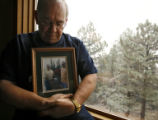 DLM02717   John Crisci, 65, holds a photo of himself and his partner of 30 years Michael...