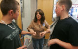 JPM586 - School supervisor Nancy Stark, center, good-naturedly chastises sophomores Zach Zarlengo,...