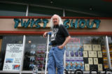 Paul Epstein (cq) stands on a ladder in front of his Twist & Shout Records store Tuesday...